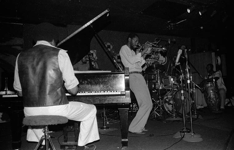 """Charles Tolliver Quintet ----- May 10, 1981 @ Maiden Voyage, downtown Los Angeles ---- Buck Clarke, congas; Sunduza William Henderson, piano; Clifford Barbaro, drums; Tony Dumas, bass ---- this evening was recorded for Jazz Alive broadcast, I recall Michael Cuscuna was there (or was that another night?) ---- photo by Mark Weber ---- I have always loved Tolliver's tune """"On the Nile"""" and Horace Tapscott kept it in his Pan Afrikan People's Arkestra book for years ---- (this is the William Henderson who recorded with Bradford & John Carter on their 1972 album SECRETS)"""
