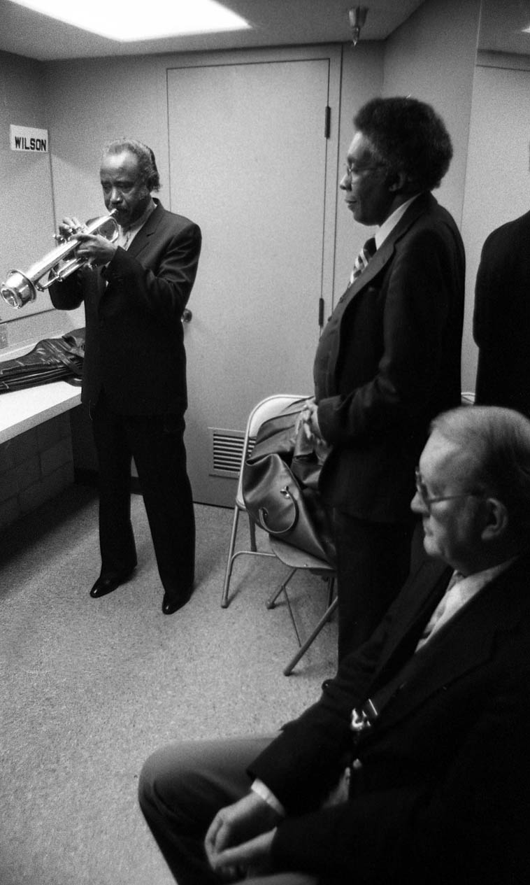 Harry Sweets Edison, Dolo Coker, Bob Cooper waiting to go on stage -- Kinsey Auditorium, Museum of Science & Industry -- December 28, 1980, Los Angeles (Quintet led by Edison & Cooper w/ Dolo, piano; Harvey Newmark, bass; Bruno Carr, drums) -- photo by Mark Weber -- Listening to Sweets live always sounded like someone ice skating -- I always got an image of swirling ice skaters gracefully floating over a frozen pond on a sunny day
