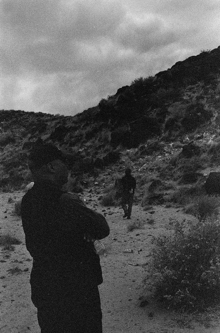 We're listening to Roswell up on the mesa top playing his trombone to the petroglyphs -- March 20, 2000 -- photo by Mark Weber ----- that's John Betsch in foreground and JJ walking