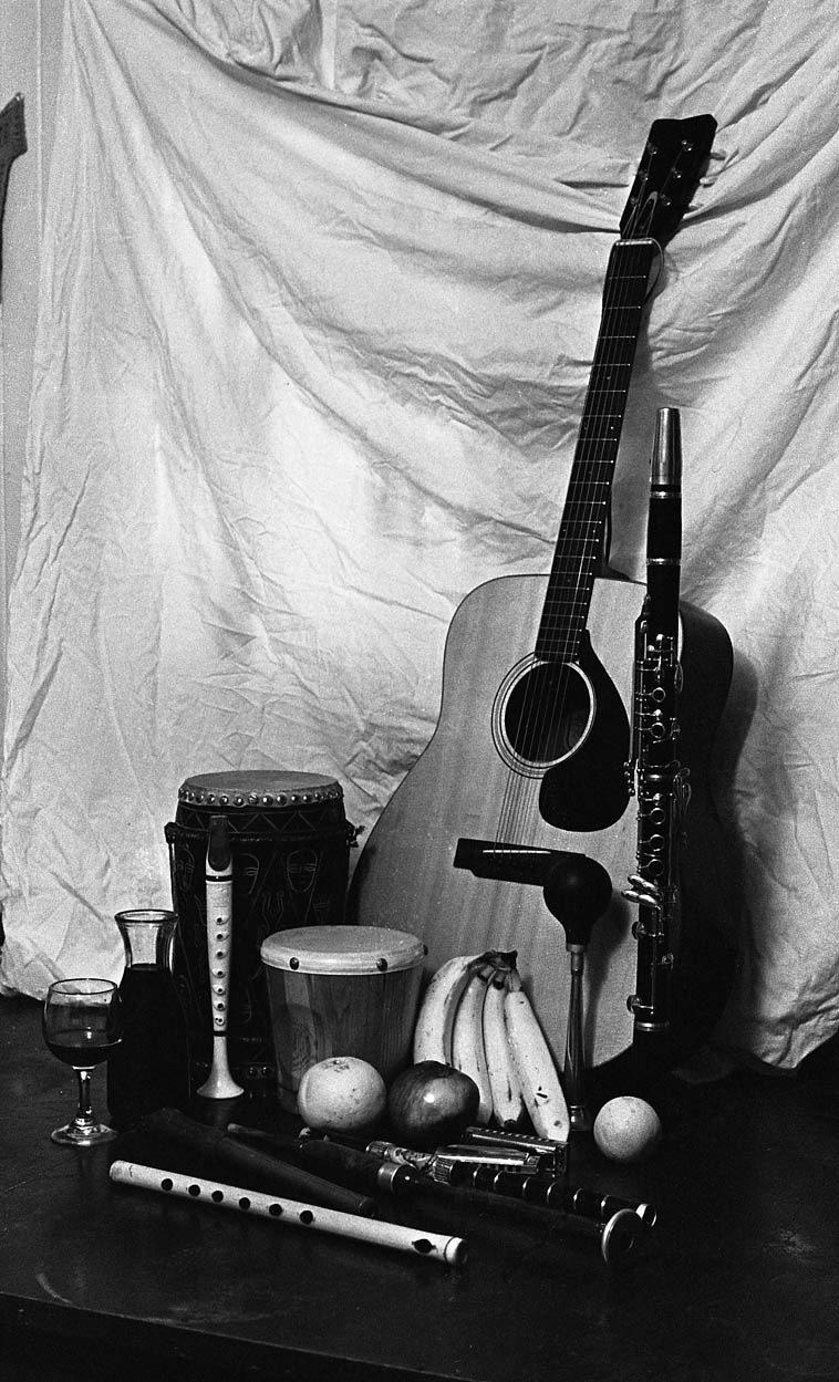 Still Life w/ flutes, guitar, bongos & bananas by Mark Weber -- 1977, Upland CA