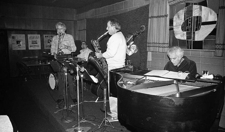 Lanny Morgan - Jack Nimitz Quintet in Cucamonga!  on Route 66 no less ---- November 9, 1980 --  Dick Berk, drums; Andrew Simpkins, bass; Lou Levy, piano; Lanny Morgan, alto saxophone -- my 4 favorite baritone saxophonists are: Lars Gullin, Arlen Asher, Bob Gordon, AND Jack Nimitz ---- I love their smooth  round mellow Prez sound they get on that horn ----- Jack was wearing a shirt that said on the front in  capital letters SUPER WHAT?  referring of course to Supersax, of which these guys were all members  at one time or another . . . . .photo by Mark Weber  (Cucamonga is about an hour east of Los Angeles)