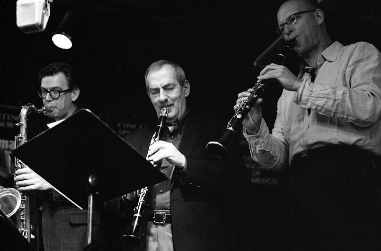 Kenny Davern as member of the ICP ---- March 17, 2003 ---- Outpost Performance Space,  Albuquerque ---- KD flanked by Ab Baars and Michael Moore ---- photo by Mark Weber ---- One  wonders when they're going to release the recordings of this incredible evening?