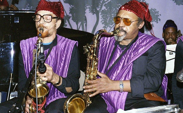 "Oakland tenor Ronald Wilson sitting in with the Arkestra this night, with Marshall Allen, alto -- December 4, 1985 -- photo by Mark Weber -- (Ronald Wilson made records with Ra in 1960 in Chicago among other jazz  dates in that town, so I guess he had migrated to the Bay Area) ---- Sun Ra has a lot of fun turning pop tunes into Sun Ra philosophical statements, as in ""I'll Never Be The Same"" this night, as well as Ellington's ""Hokus Pokus"""