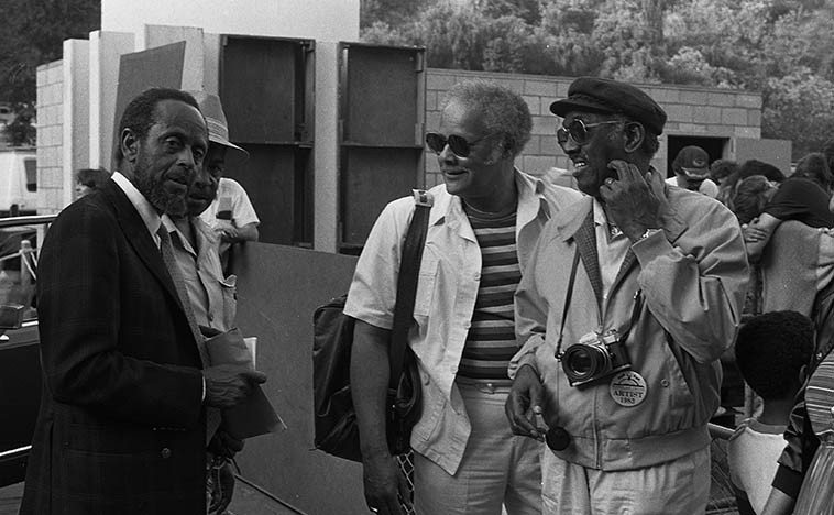 The master of walking bass: Percy Heath with Jerome Richardson backstage Hollywood  Bowl for Playboy Jazz Festival -- June 18, 1983 -- photo by Mark Weber