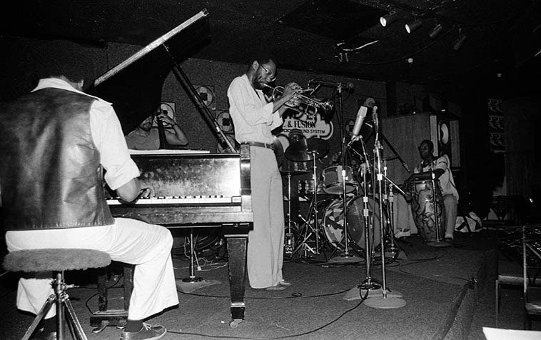 Charles Tolliver Quintet -- all the microphones are for a recording, I think Jazz Alive, ask Michael Cuscuna, he was there -- May 10, 1981 at Maiden Voyage, Los Angeles -- Tony Dumas, bass; Bill Sunduza Henderson, piano; Buck Clarke, conga; Clifford Barbaro, drums -- photo by Mark Weber