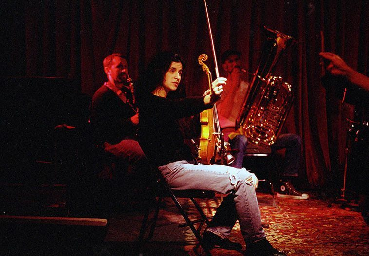 Rehearsal at Outpost ---- J.A. Deane's Out of Context: Tom Guralnick (soprano), Alicia Ultan (viola), Mark Weaver (tuba), and Dino's hand signal -- November 21, 1997 -- photo by Mark Weber