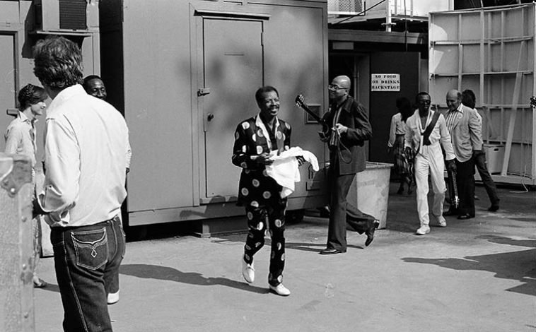 "Ornette Coleman & Prime Time coming off stage of Hollywood Bowl -- June 19, 1982 Playboy Jazz Festival -- photo by Mark Weber ------ I recently reread THE BATTLE OF THE FIVE SPOT: ORNETTE COLEMAN AND THE NEW YORK JAZZ FIELD(2006, 2014) by David Neil Lee, and distance (50+ years) is ideal for historical perspective. This study endeavors to quantify how the opinions and conventions and peer pressure and the dynamics of right place, right time, came together, for better or worse, and how Ornette withstood the powder keg barrage simply because he truly had something of worth to add to jazz. The ground zero paragraph (among many) in this very good book happens on page 34: ""The more populist tendencies of hard bop, the art music experiments of Third Stream, and the tempered bebop style of cool jazz were all attempts to forge a jazz identity that could move outside of the influence of Charlie Parker. The idea of a technical development of jazz, onward and upward, was stalled behind a barrier of technique."""