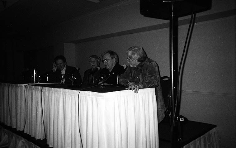 Panel discussion on Lennie Tristano at the Springsville Cool Jazz Conference: Dave MacKay, Billy Bauer, Ted Brown, Don Heckman (moderator) and a minute later Lee Konitz sat in -- May 28, 2004 -- this photo is so funky because I was laboring under the illusion of how cool it was to use the cheapest cameras available -- this is something I gleaned from Robert Frank -- but, those little $10 plastic disposable cameras are junk -- most of the shots on that camera are toast