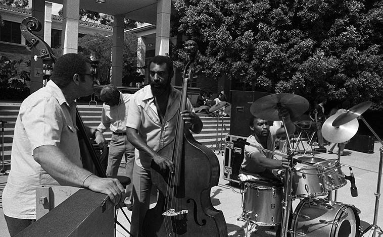 """May 16, 1981 -- Three bassists and a drummer -- Left to right: Al Hines, David Bryant, Henry Franklin, Fritz Wise -- There's a lot of history in that photograph: Al worked as a music director at Hanna-Barbera; David has the distinction for being Billie Holiday's bassist on the coast, and is the subject of Horace Tapscott's tune """"Dee Bee's Dance""""; Henry's history in L.A. goes way back, his father was big band leader Sammy Franklin, Henry studied bass with Al McKibbon, and George Morrow, and if you look hard enough you can see him in the film Monterey Pop (June 1967) with Hugh Masekela (Henry was on the mega-hit """"Grazing in the Grass"""") -- photo by Mark Weber"""