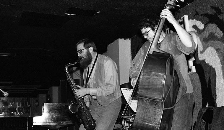 Lew Tabackin Trio at Maiden Voyage downtown Los Angeles -- January 26, 1980 -- Charlie Haden, bass -- Lew on tenor & flute -- photo by Mark Weber -- I wonder who was the first to play in this most powerful configuration? I love an exposed trio like this: bass drums horn, was it Rollins that showed us the way?