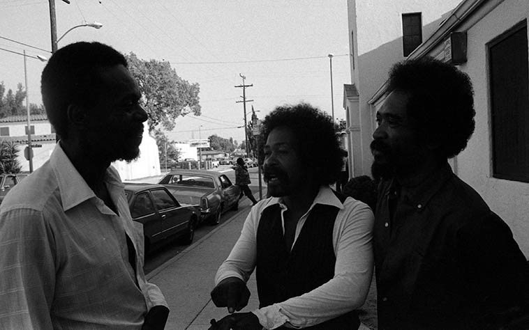 Left to right: Horace Tapscott, Moises Obligacion, Lester Robertson outside Immanuel United Church of Christ, 85th & Holmes, Los Angeles, for their regular last-Sunday-of-the-month concert -- June 28, 1981 -- photo by Mark Weber -- Lester was one of Horace's closest friends, and the trombonist on some of Gerald Wilson Orchestra's great recordings, as well as with Dizzy Gillespie, among others, was the trombonist in Eric Dolphy's last quintet before he moved to NYC -- Moises played conga in the Pan Afrikan People's Arkestra