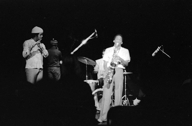 David Murray Trio at Century City Playhouse, Los Angeles -- January 6, 1977 ---- David in town from NYC -- trio was local cat Roberto Miranda (bass) and maybe he brought Oliver Johnson with? on drums -- Sitting in: John Carter (clarinet, with his back to camera) and James Newton (flute) ---- photo by Mark Weber