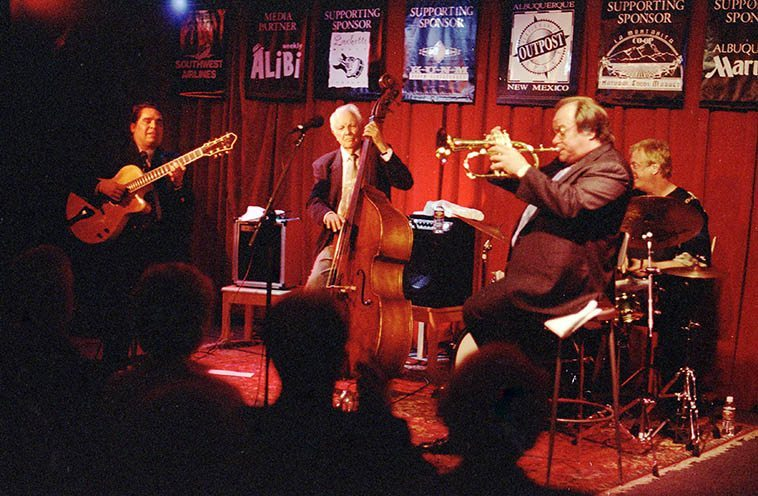 "Bob Haggart Quartet -- May 4, 1998 -- Outpost Performance Space, Albuquerque ---- Bob on bass; Butch Miles, who lived in Albuquerque at the time, on drums; Warren Vache (cornet & flugel); Howard Alden on 7-string Benedetto guitar, of which I seem to recall he told me it was on loan from Bucky? George Van Eps? I can't remember exactly, but he was trying it out, I remember that ----- I got to pick them up at the hotel to drive to the gig and with Bob in the front seat I asked (I have a devil in my soul) Hey are you going to play ""Big Noise from Winnetka""? and Bob said, ""Oh, Mark, you don't want to hear that do you?"" and I said Sure I do ---- Well, they played it, and amazing best version I've ever heard ---- ""Big Noise from Winnetka"" is a novelty ditty that Bob recorded with the Bob Crosby Bobcats in 1938 in duet with drummer Ray Bauduc, and I gather it's been an albatross around Haggart's neck ever since --- when they played it, Butch came over and played Bauduc's part on Haggarts strings and Warren played the whistling part on cornet (I imagine you could find it on YouTube) ------- Here's a trivia NOTE: David Parlato once played ""Big Noise"" on Lawrence Welk television show with his father, who was long-time trumpeter for that great band, and with his brother Chris hammering on the bass strings with his drum sticks -- I have it on VHS, it was a Lawrence Welk show where he invited the orchestra's family members to perform, circa 1970, David had that beard you see on Warne Marsh's album NE PLUS ULTRA"