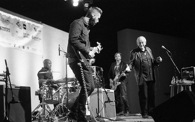 Charlie looked at me with my camera and then struck a pose, great guy that he is ---- and one of my favorite bluesmen and purely distinctive sound on the harp: Charlie Musselwhite Blues Band: June Core(drums), Matthew Stubbs(guitar), Jesse Ingalls(bass) at Albuquerque Museum Amphitheater -- May 22, 2o15 -- photo by Mark Weber