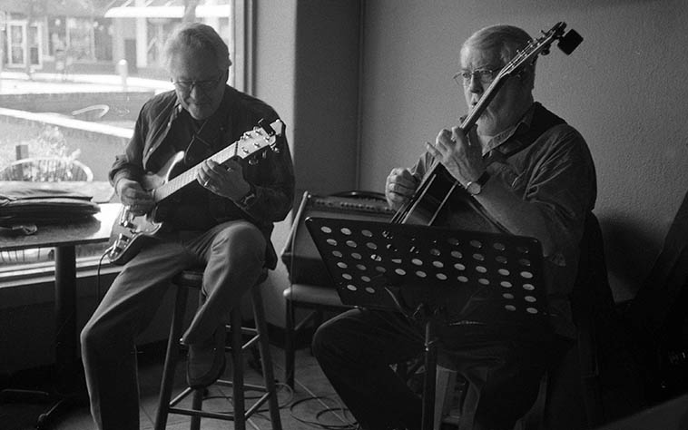 Two guitarists working a Sunday brunch gig on Nob Hill in Albuquerque: the legendary Bob Brown, who's played around these parts since the 60s, and newcomer Bill West -- club gigs are where jazz really exists, these guys are in the trenches, playing the Song Book and having a good time -- photo by Mark Weber
