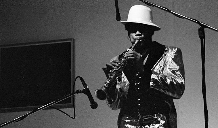 Julius Hemphill during his solo Roi Boye & Gotham Minstrels tour playing at Studio Z, 2409 W. Slauson Avenue, Los Angeles -- either March 22 or 23, 1977 (he played this audio drama two nights running) -- Photo by Mark Weber ----- Julius played alto saxophone, flute, and soprano saxophone along with pre-recorded tapes, mostly of NYC subway sounds . . . . . .