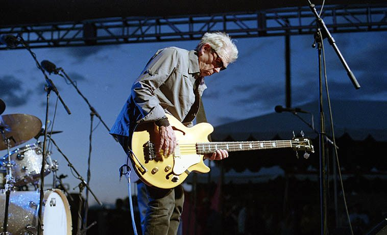 Jack Casady -- July 10, 2o16 playing with Electric Hot Tuna in Madrid, New Mexico -- photo by Mark Weber ---- One of my early heroes of the electric contrapuntal bass, I learned a lot listening to him ---- I wonder what occasion'd Jack's decision to take up residence on the Island of Jersey off the coast of Normandy? (There's important paleolithic sites of Neanderthals 250,000BP on Jersey)