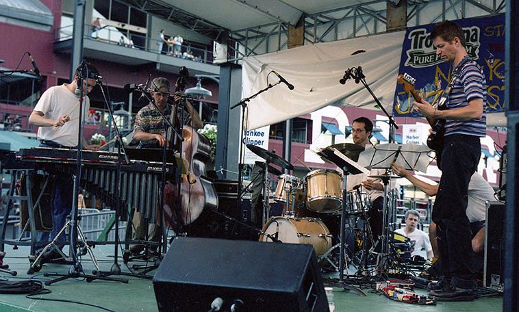 Greg Bendian & INTERZONE at South Street Seaport Park, NYC -- June 28, 1997 ---- Greg(vibes), Mark Dresser(bass), Mike Sarin(drums), Nels Cline(guitar), and that looks like Herb Robertson behind the drums, who's band played after INTERZONE on this afternoon---- photo by Mark Weber