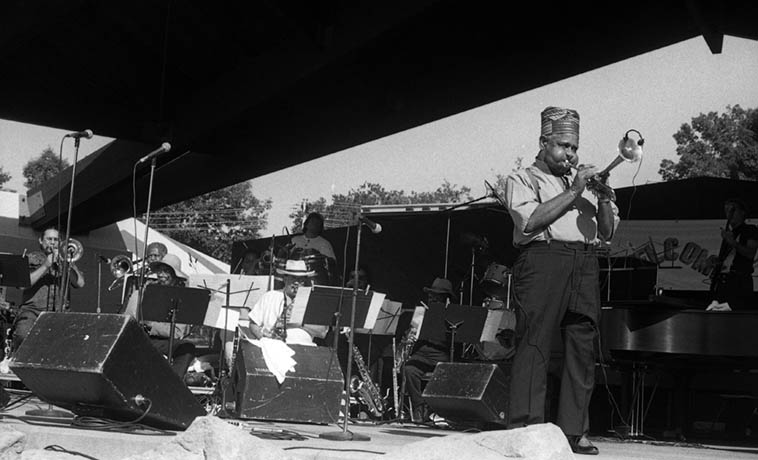 The hippest trumpeter that ever lived: Dizzy Gillespie with his United Nations Festival Superband at Metro Cleveland Zoo -- August 21, 1988 ---- Steve Turre & Slide Hampton(trombones), Sam Rivers(tenor), Paquito D'Rivera(alto), Jon Faddis & Claudio Roditi(trumpets), James Moody(tenor), John Lee(elec-bass), along with Flora Purim, Monty Alexander, Airto, Ed Cherry, Ignacio Berroa, Giovanni Manenguito Hidalgo ---- photo by Mark Weber