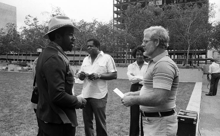 Donald Byrd (center) visits with Clare Fischer after performance of Clare's Salsa Picante at the Bonaventure Hotel, downtown L.A. (I don't know who the guy in the hat is, or the lady) -- August 18, 1980 -- photo by Mark Weber ---- Donald Byrd and Clare Fischer's work together goes back to 1959 when they did that project with strings