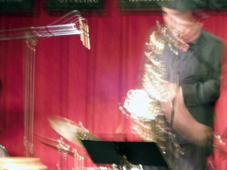 I never could get that little shirtpocket digital camera to work right, so it's gone ---- Some of the shots are variously interesting (for a minute) this one looks abstract expressionist ----- saxophonist Doug Lawrence -- Albuquerque April 20, 2o17 -- photo by Mark Weber