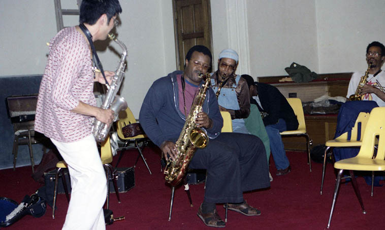 Old friends: Ray Collins on tenor and Lewis Jordan on alto (far right) at Idris Ackamoor rehearsal, at the New College – a 12-piece aggregation – August 14, 1979 – the other two altos in shot: Russell Baba and Idris ---- photo by Mark Weber