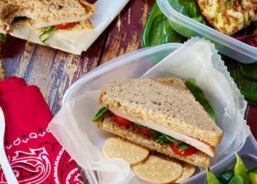 Healthy turkey sandwich, fresh fruit and frittata.