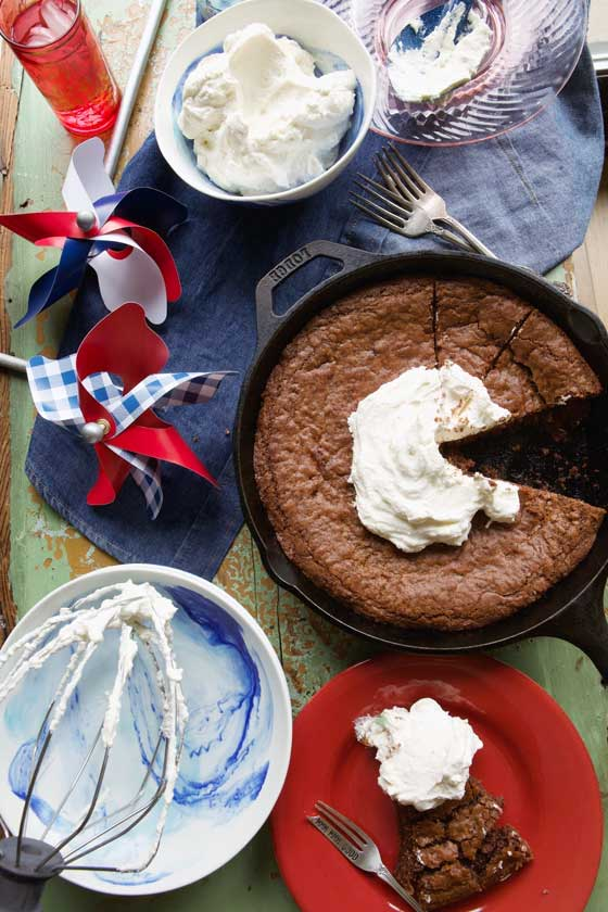 This easy & delicious Skillet Brownie with Maple Whipped Cream recipe is great for any kind of entertaining, potluck parties or any time you want a sweet chocolatey treat! MarlaMeridith.com