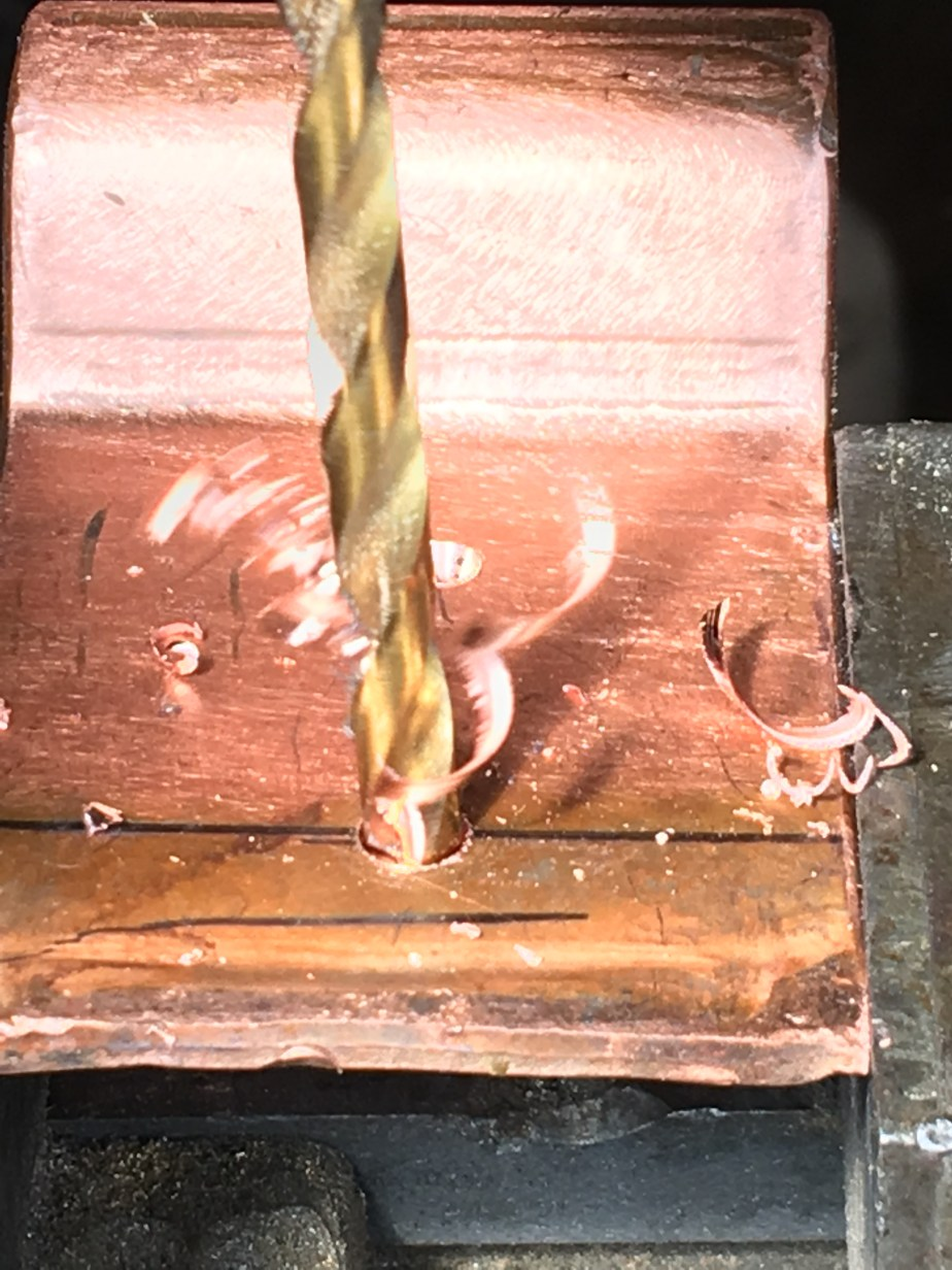 drilling a hole in the copper bracket