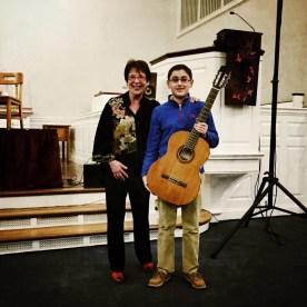 Myrna Sislen, Middle C Music, and the Guitar Raffle winner, Carlos Olivares, Beatty Competitor
