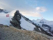 Swiss flag on a mountain ridge