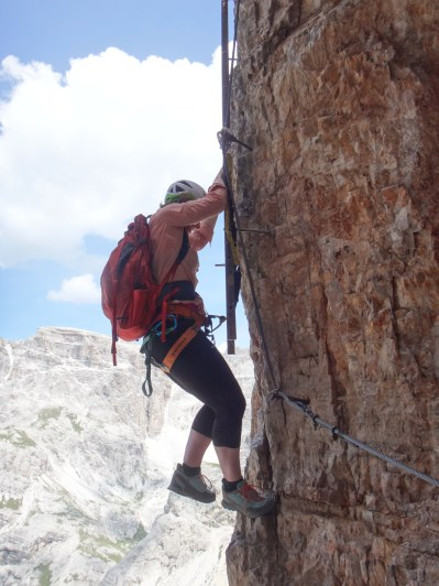 Climbing a via ferrata at the Lovatelli hut in the Dolomites