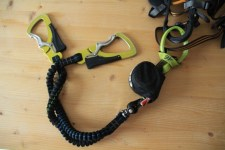 A via ferrata lanyard attached to a climbing harness