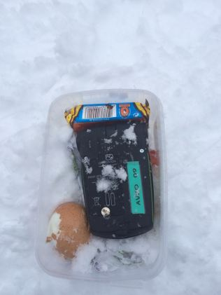 an avalanche transceiver in a lunch box