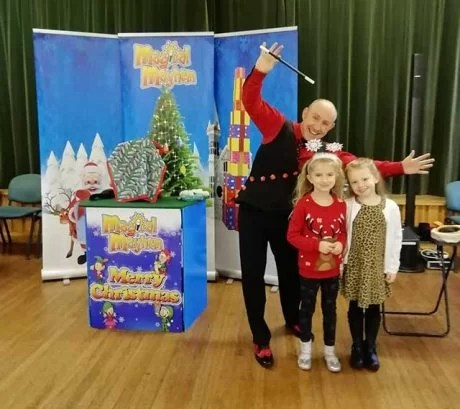Children with magician at Christmas Party