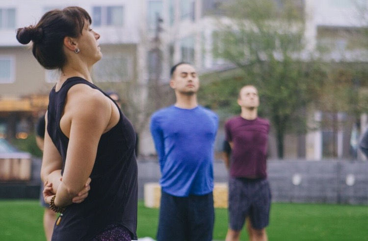 Community Outdoor Yoga at Lake Walk in Traditions