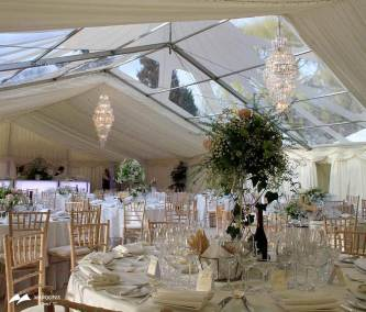 Interior marquee set for wedding and see through roof