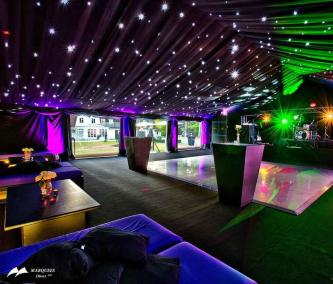 Image of party marquee with black walls, flooring and walls with LED lights on roof