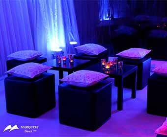 Image of black cube seating and black coffee tables