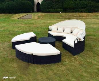 Image of Outdoor/Indoor black rattan furniture; chairs and comfort seating with cream cushions