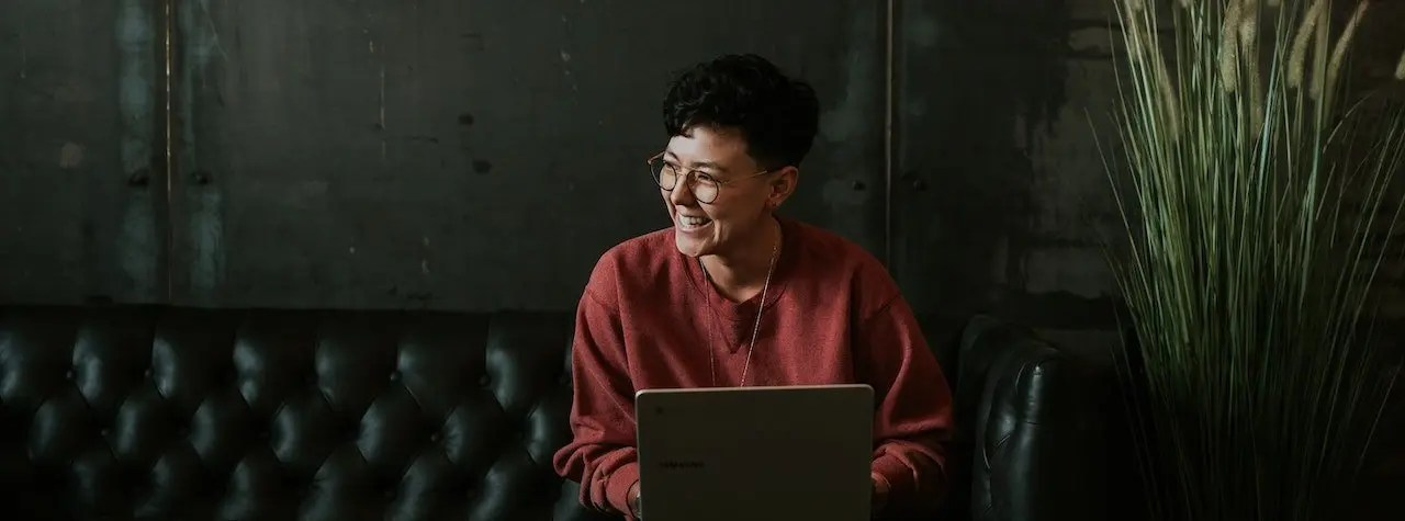 Woman on laptop smiling