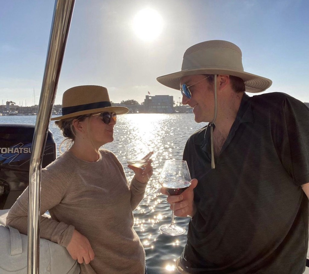 Tim and Kara with wine on the stern of the yacht