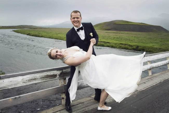Married dancing on a bridge in Iceland
