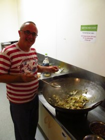 Matt, the hostel owner, preparing a big old dinner in the wok.