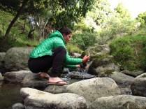 Rinsing socks in the creek.