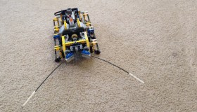 """""""My kids enjoy playing with the Lego characters and making them do stuff, like sharks eating people,"""" Jungheim says. """"They do adventures together. Me, I tend to find myself in the corner building some crazy contraption that's remote controlled."""" When it comes to Lego robots, like this bug, Jungheim does his own code programming."""
