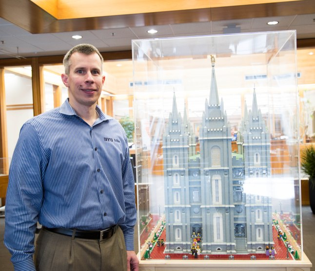 Jungheim poses with the work that took him over nine years and 35,000 Lego pieces to build. Photo/Maude Lee