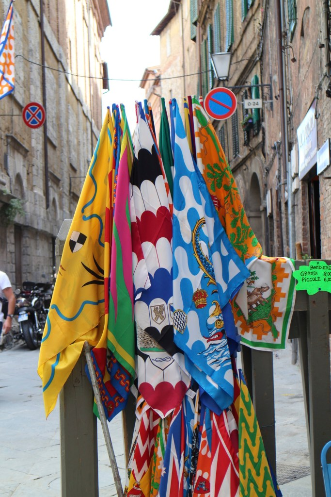 The Palio di Siena (known locally simply as Il Palio) is a horse race that is held twice each year, on July 2 and August 16, in Siena, Italy. Ten horses and riders, bareback and dressed in the appropriate colours, represent ten of the seventeen contrade, or city wards.