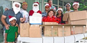 Santa Claus appeared to have a twin brother during the Kramer/Muller family visit to Majuro hospital to spread holiday cheer to patients and staff. Photo: Brett Schellhase.