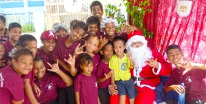 Students from Majuro's Deaf Education Center enjoyed their moment with a Santa who dropped into the College of the Marshall Islands. Photo: Kelly Lorennij.